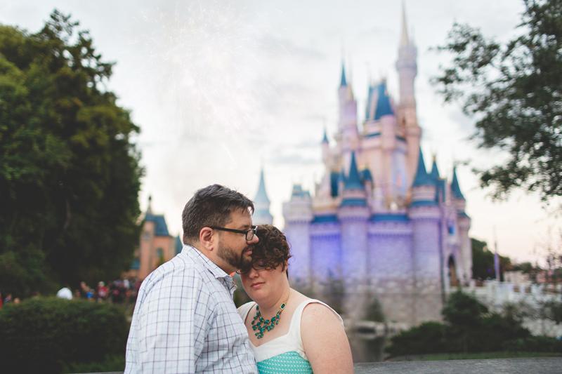 Disney photos of engagement - Jaime DiOrio Disney Photographer-Magic Kingdom photo shoot-Disney family session - family photos - couple castle purple.jpg