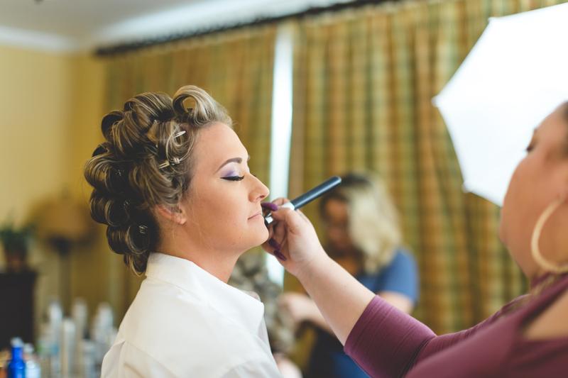 Tradewinds Island Grand Resort beach wedding - st pete beach - Jaime DiOrio Photography - Destination Orlando wedding photographer -  (11) bride getting makeup done.JPG