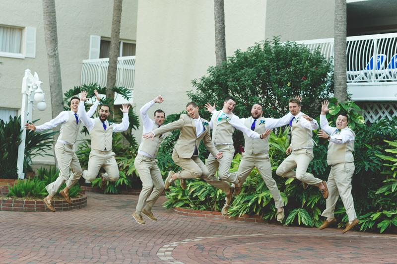 Funny wedding party groomsmen jumping photo - Tradewinds Island Grand Resort beach wedding - st pete beach - Jaime DiOrio Photography - Destination Orlando wedding photographer -  (30).JPG