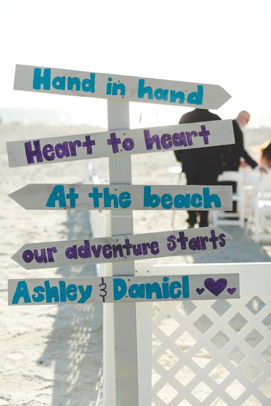 Teal and Purple ceremony sign - Tradewinds Island Grand Resort beach wedding - st pete beach - Jaime DiOrio Photography - Destination Orlando wedding photographer -  (31).JPG