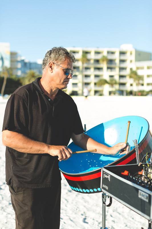 Steel drum player - Tradewinds Island Grand Resort beach wedding - st pete beach - Jaime DiOrio Photography - Destination Orlando wedding photographer -  (35).JPG