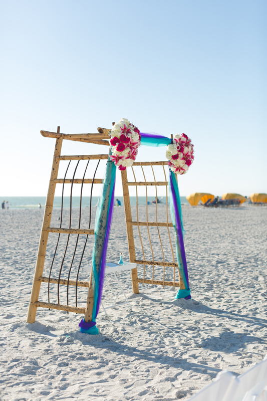 Bamboo arch for beach ceremony with orchids - Tradewinds Island Grand Resort beach wedding - st pete beach - Jaime DiOrio Photography - Destination Orlando wedding photographer -  (37).JPG