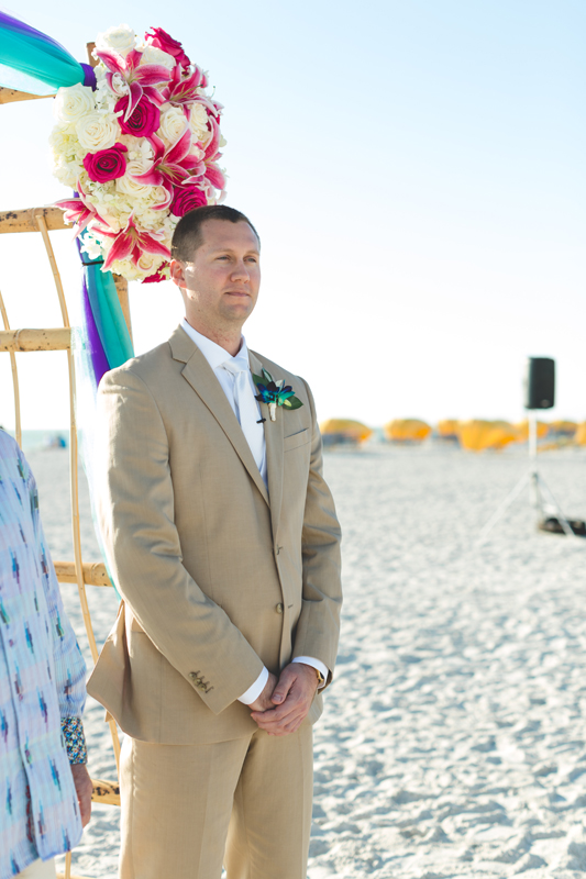 Groom waiting for Bride to walk down aisle - Tradewinds Island Grand Resort beach wedding - st pete beach - Jaime DiOrio Photography - Destination Orlando wedding photographer -  (40).JPG