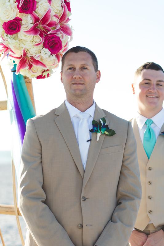 Groom at front of ceremony - Tradewinds Island Grand Resort beach wedding - st pete beach - Jaime DiOrio Photography - Destination Orlando wedding photographer -  (41).JPG