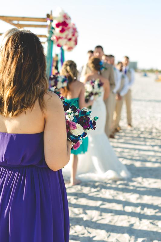 Bride and Groom during ceremony - Tradewinds Island Grand Resort beach wedding - st pete beach - Jaime DiOrio Photography - Destination Orlando wedding photographer -  (43).JPG