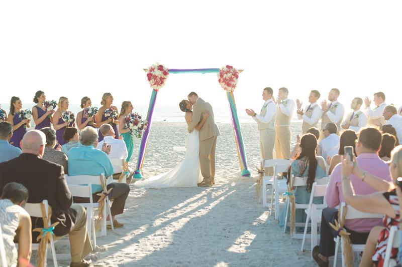 First kiss at beach ceremony - Tradewinds Island Grand Resort beach wedding - st pete beach - Jaime DiOrio Photography - Destination Orlando wedding photographer -  (47).JPG