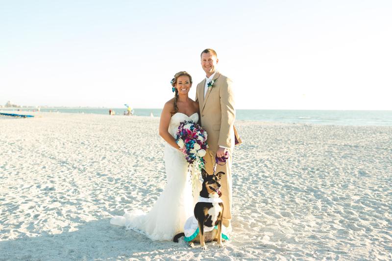Bride and Groom portrait with dog - Tradewinds Island Grand Resort beach wedding - st pete beach - Jaime DiOrio Photography - Destination Orlando wedding photographer -  (49).JPG