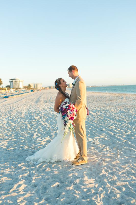 Bride and Groom on their wedding day - Tradewinds Island Grand Resort beach wedding - st pete beach - Jaime DiOrio Photography - Destination Orlando wedding photographer -  (54).JPG