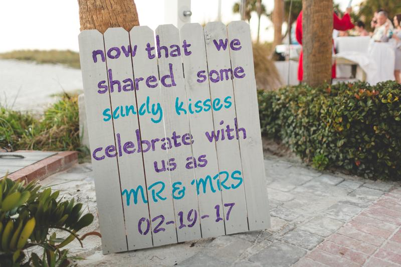 Sandy kisses sign - Tradewinds Island Grand Resort beach wedding - st pete beach - Jaime DiOrio Photography - Destination Orlando wedding photographer -  (60).JPG