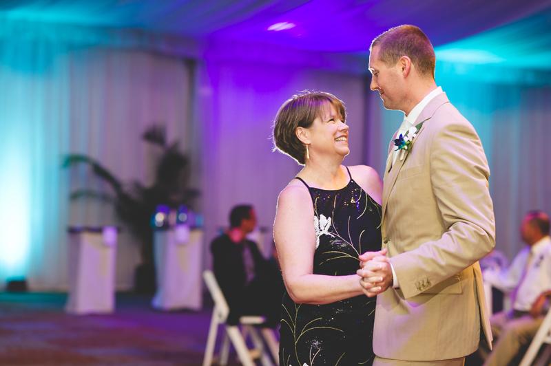 Groom dancing with mother at wedding reception - Tradewinds Island Grand Resort beach wedding - st pete beach - Jaime DiOrio Photography - Destination Orlando wedding photographer -  (65).JPG