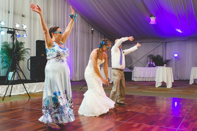 Bride with parents dancing at reception - Tradewinds Island Grand Resort beach wedding - st pete beach - Jaime DiOrio Photography - Destination Orlando wedding photographer -  (67).JPG