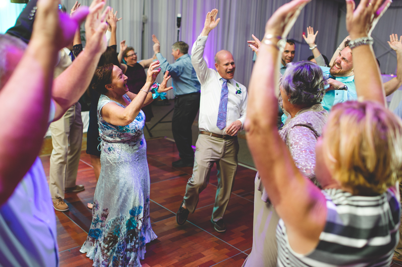 Guests dancing at beach wedding reception - Tradewinds Island Grand Resort beach wedding - st pete beach - Jaime DiOrio Photography - Destination Orlando wedding photographer -  (68).JPG