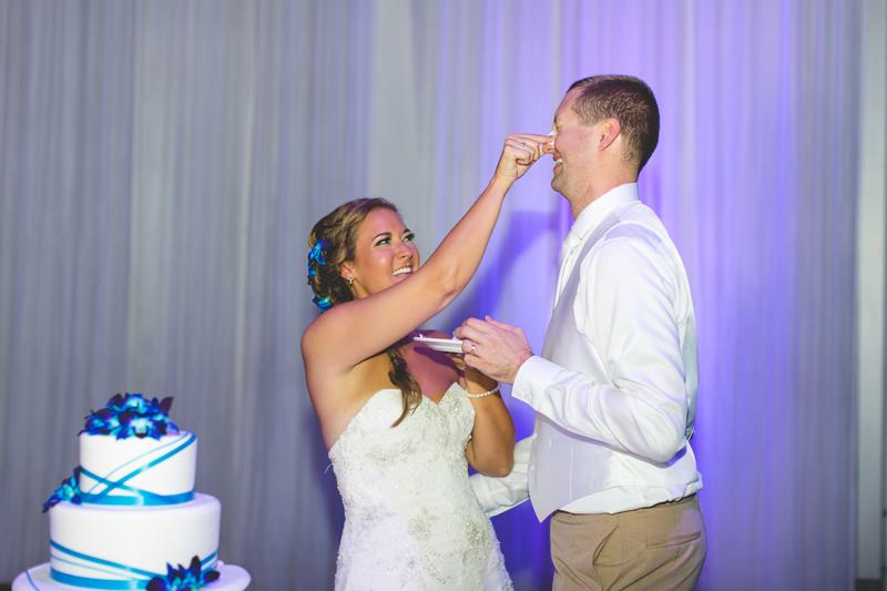 Bride and Groom cake smash - Tradewinds Island Grand Resort beach wedding - st pete beach - Jaime DiOrio Photography - Destination Orlando wedding photographer -  (70).JPG