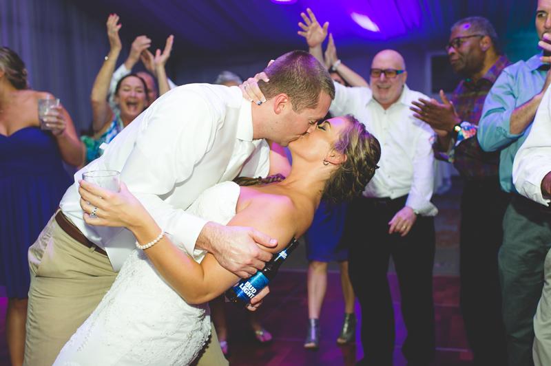 Bride and Groom kissing on the dance floor - Tradewinds Island Grand Resort beach wedding - st pete beach - Jaime DiOrio Photography - Destination Orlando wedding photographer -  (72).JPG