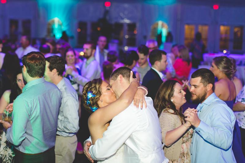 Wedding reception bride and groom kissing - Tradewinds Island Grand Resort beach wedding - st pete beach - Jaime DiOrio Photography - Destination Orlando wedding photographer -  (75).JPG