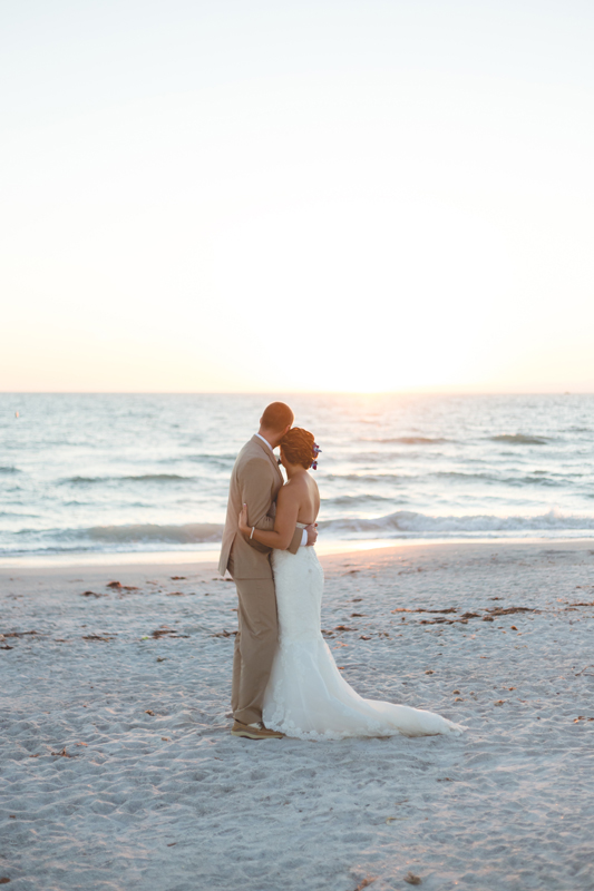 Bride and Groom wedding photo on beach - Tradewinds Island Grand Resort beach wedding - st pete beach - Jaime DiOrio Photography - Destination Orlando wedding photographer.jpg