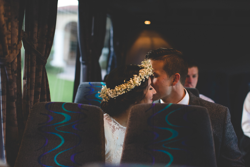 Bride and Groom kissing on bus - bohemian inspired outdoor wedding at Mission Inn Resort - howey in the hills fl - destination orlando wedding photographer - Jaime DiOrio (12).jpg
