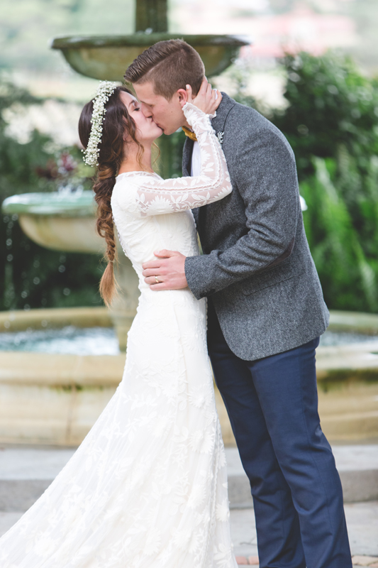Bride and Groom first kiss - bohemian inspired outdoor wedding at Mission Inn Resort - howey in the hills fl - destination orlando wedding photographer - Jaime DiOrio (62).jpg