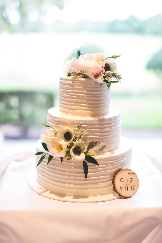 Buttercream wedding cake with anemones - bohemian inspired outdoor wedding at Mission Inn Resort - howey in the hills fl - destination orlando wedding photographer - Jaime DiOrio (27).jpg