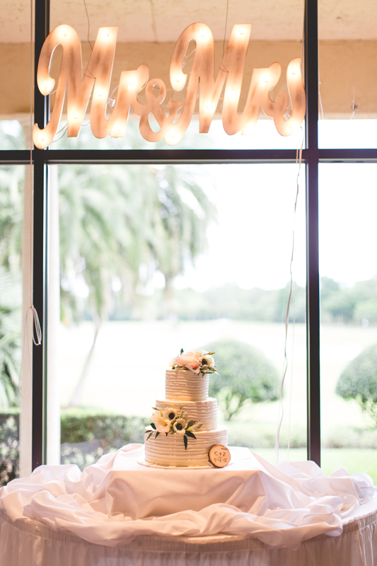 Wedding light up sign over cake - bohemian inspired outdoor wedding at Mission Inn Resort - howey in the hills fl - destination orlando wedding photographer - Jaime DiOrio (33).jpg