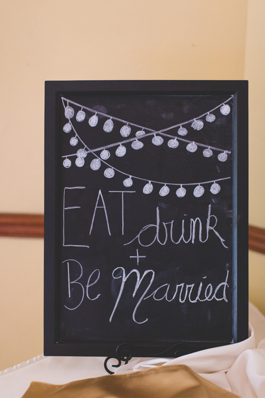 Eat drink and be married chalk board sign - bohemian inspired outdoor wedding at Mission Inn Resort - howey in the hills fl - destination orlando wedding photographer - Jaime DiOrio (38).jpg
