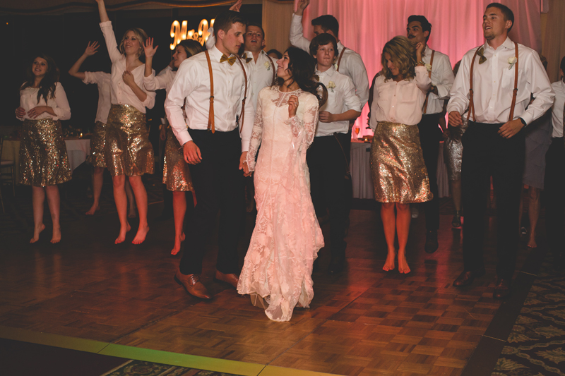 Guests dancing with bride and groom at reception - bohemian inspired outdoor wedding at Mission Inn Resort - howey in the hills fl - destination orlando wedding photographer - Jaime DiOrio (70).jpg