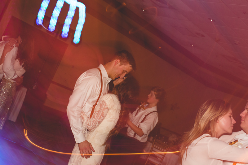 Bride and Groom dancing and kissing at reception - bohemian inspired outdoor wedding at Mission Inn Resort - howey in the hills fl - destination orlando wedding photographer - Jaime DiOrio (79).jpg