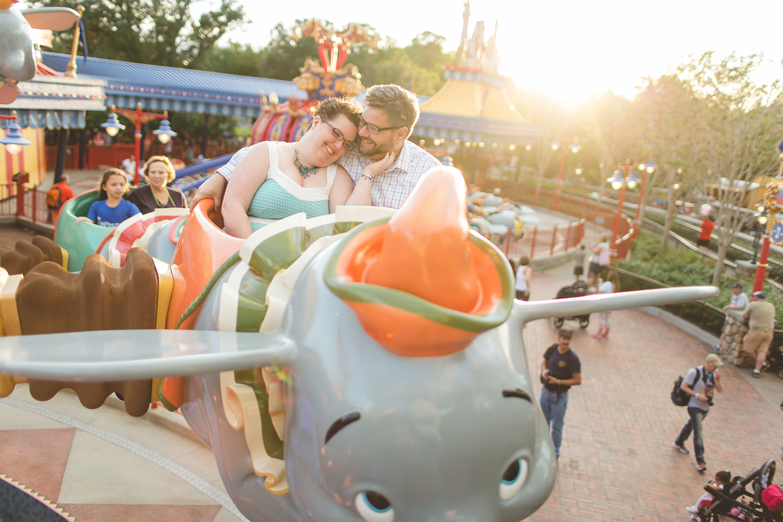 Jaime DiOrio - Disney World Engagement Photo - Orlando Wedding Photographer - Orlando Engagement Photographer - Magic Kingdom Engagement Session - Couple on Dumbo ride at Disney - Disney Anniversary photos.jpg