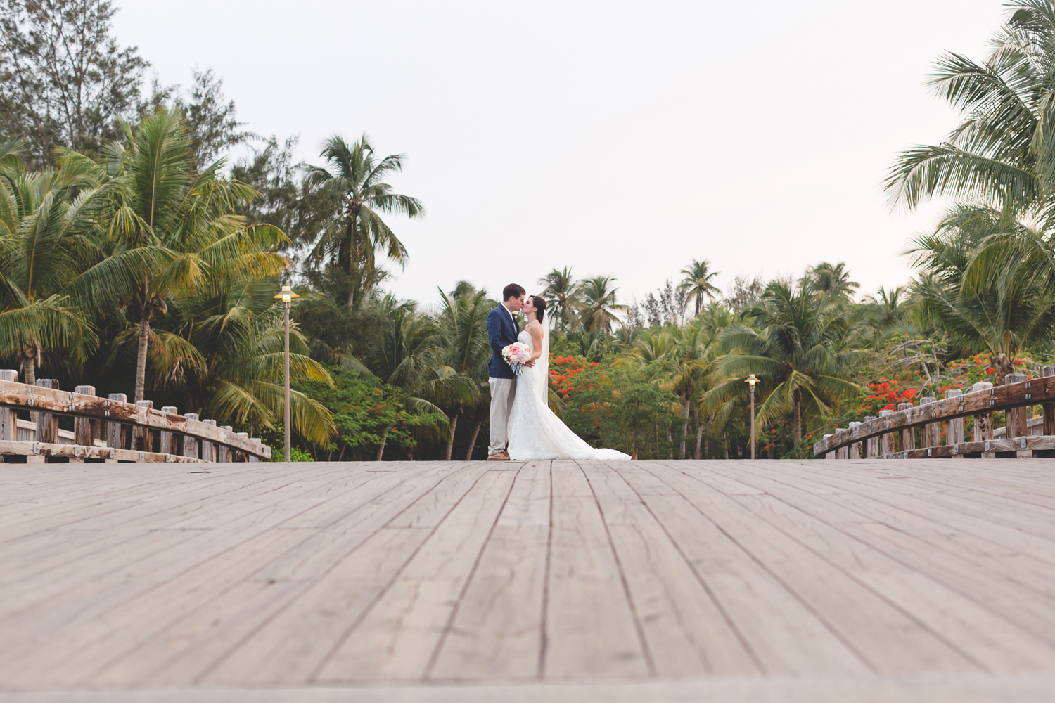 Romantic Puerto Rico Wedding Couple kissing on bridge