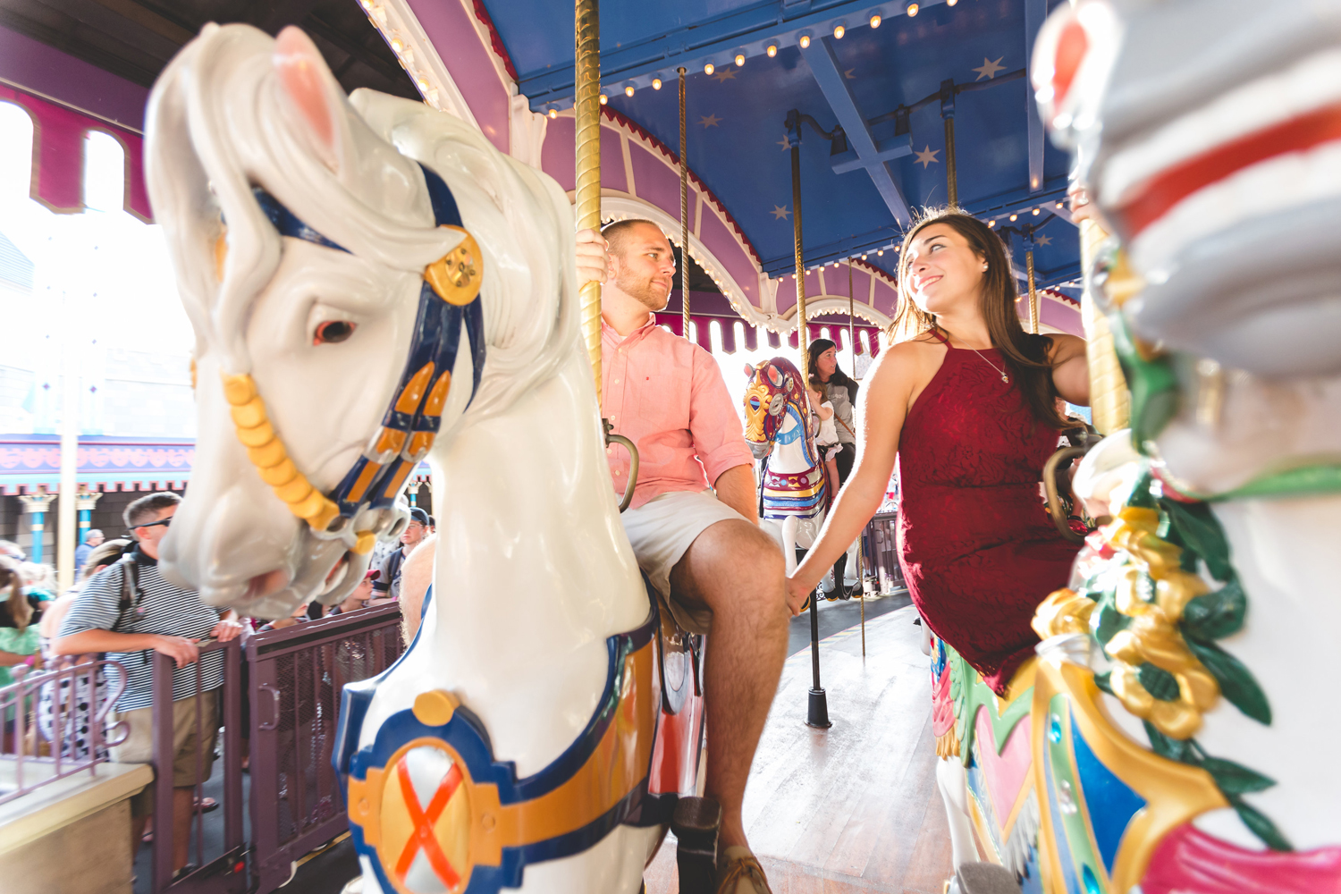 Cute Carousel engagement photo at Disney Magic Kingdom