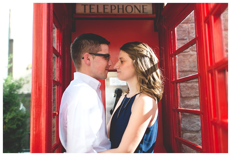 disney-epcot-engagement-photography-couple-in-a-phone-booth.jpg