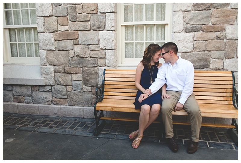disney-epcot-engagement-photography-couple-kissing-on-bench.jpg