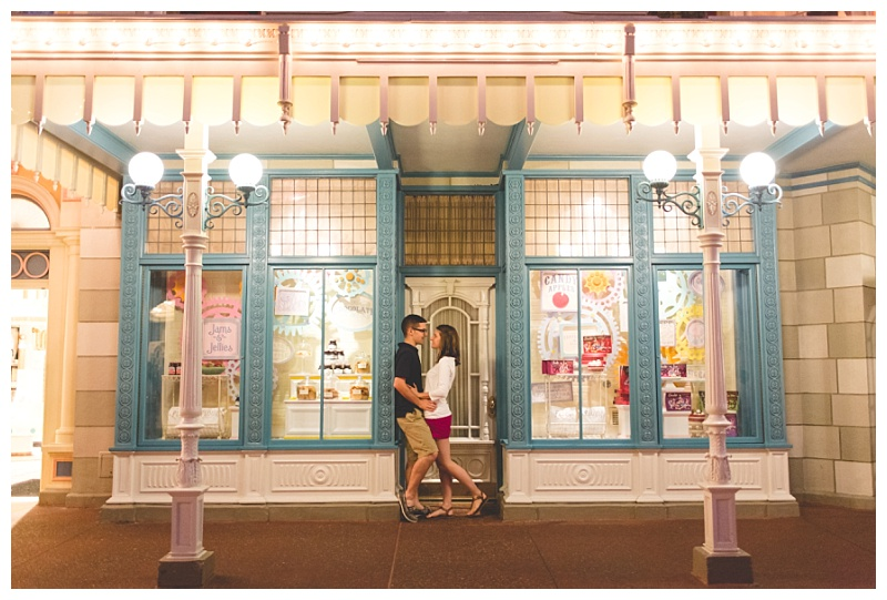 disney-epcot-engagement-photography-kissing-in-candy-shop.jpg