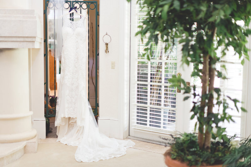 Beautiful Lace Wedding Dress hanging in Floridian Manor Estate