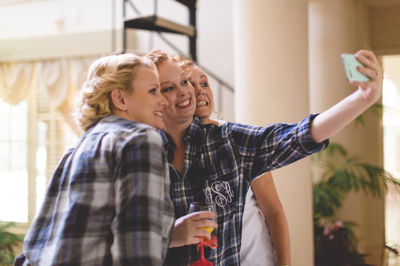 Bride taking a selfie with Bridemaids getting ready for the weddings