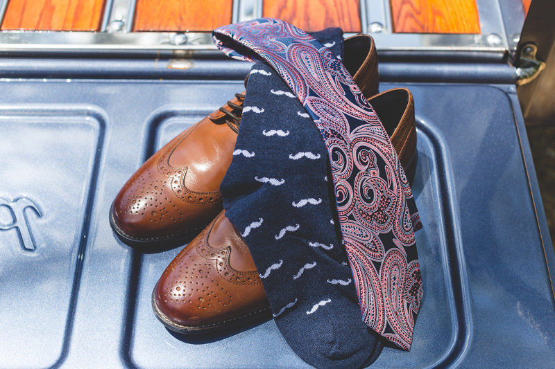 Brown oxford shoes, paisley tie and mustache socks of Groom