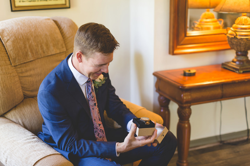 Groom opening gift from Bride on Wedding day