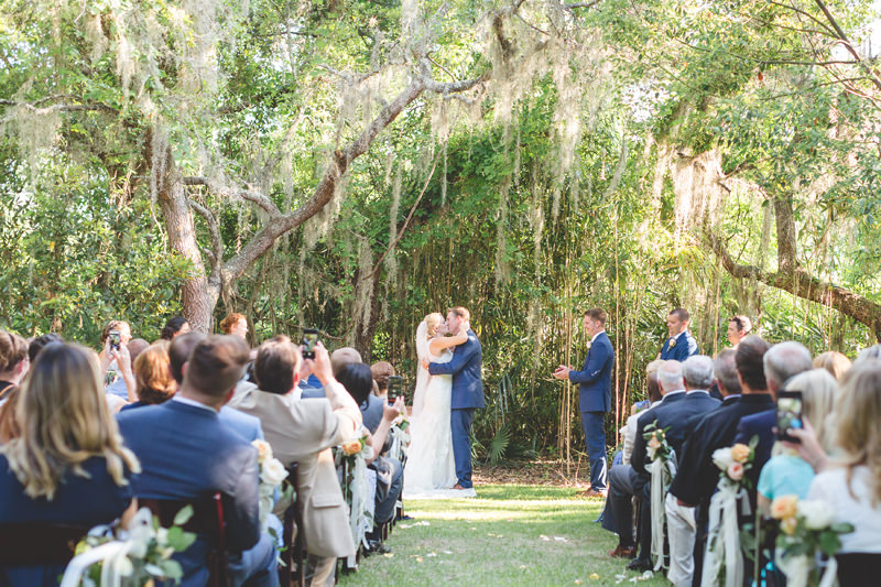 the first kiss as husband and wife at spring wedding