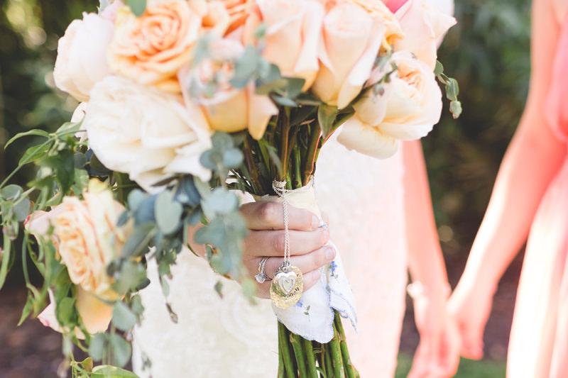 Sentimental locket on Bridal Bouquet for Spring Wedding