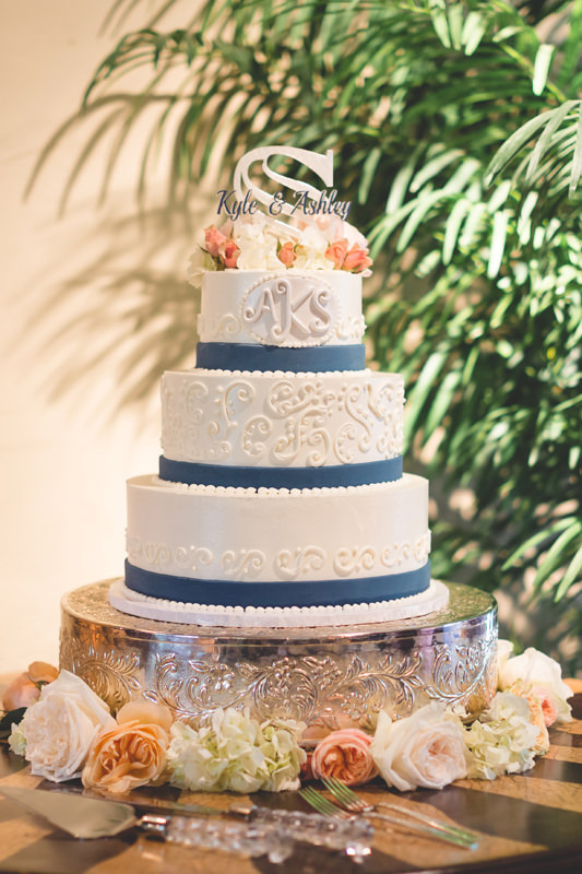 Spring wedding cake with navy blue and coral colors