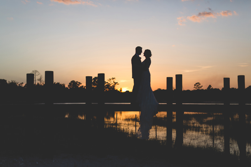 Sunset Wedding Portrait of Bride and Groom on Dock