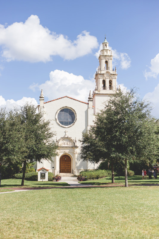 Sun shines on Knowles Memorial Chapel at Rollins College on a wedding day