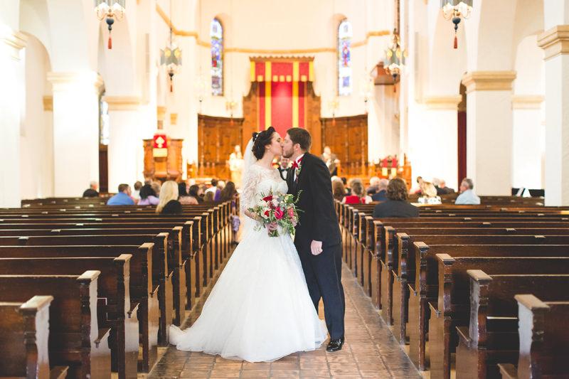 Bride and Groom kissing at Knowles Memorial Chapel Wedding