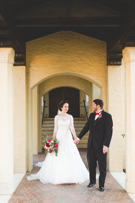 Bride and Groom holding hands at Knowles Memorial Chapel wedding