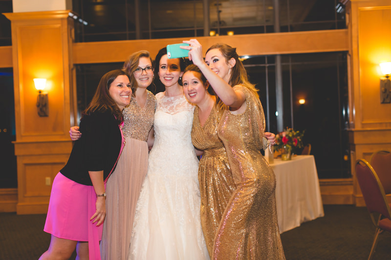 Bride taking selfie with wedding guests at Disney themed wedding