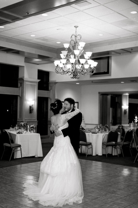 Bride and Groom slow dance at their Disney themed wedding