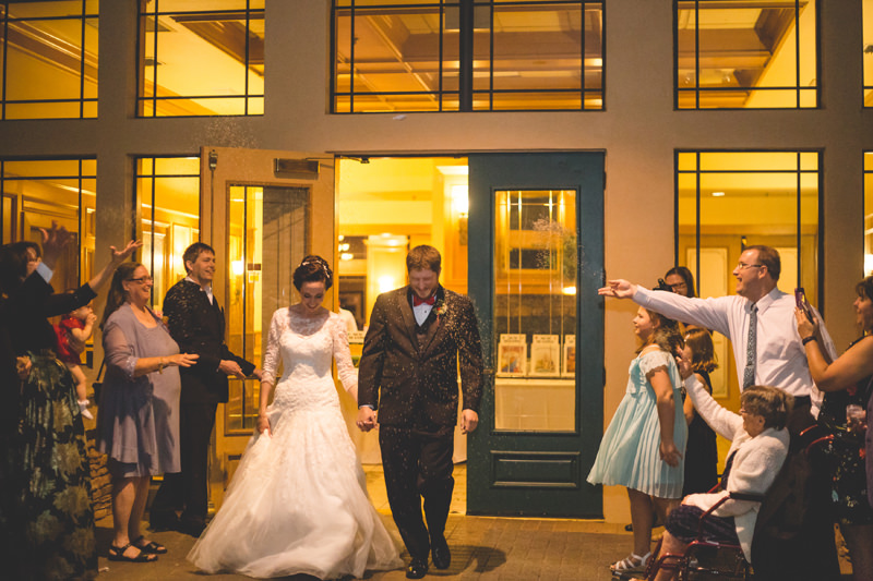 Wedding guests throw lavender on the Bride and Groom as they exit their reception