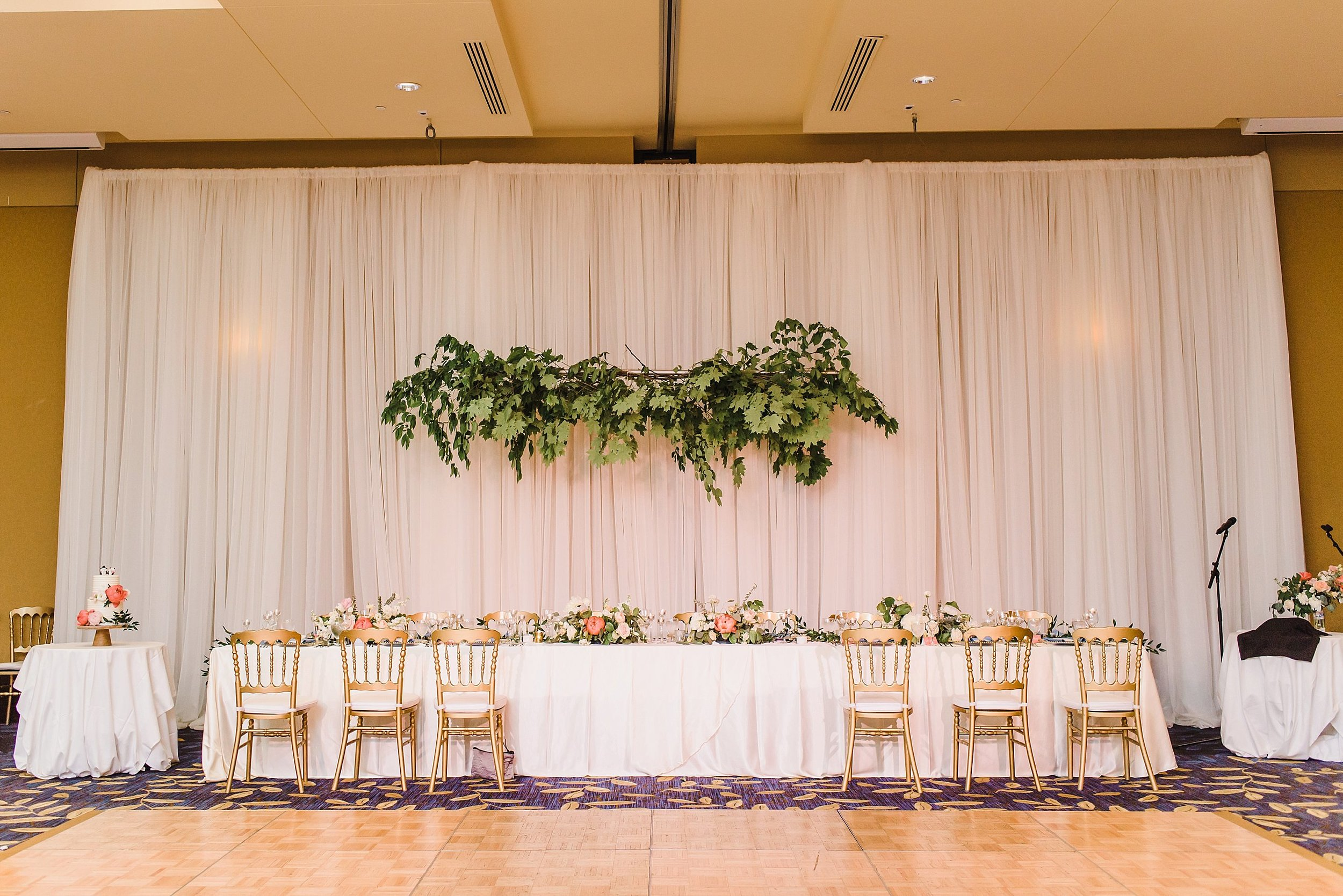 Fresh greenery, pink, nude, white flowers and lots of gold and blue linens filled the Outaouais Room that night!