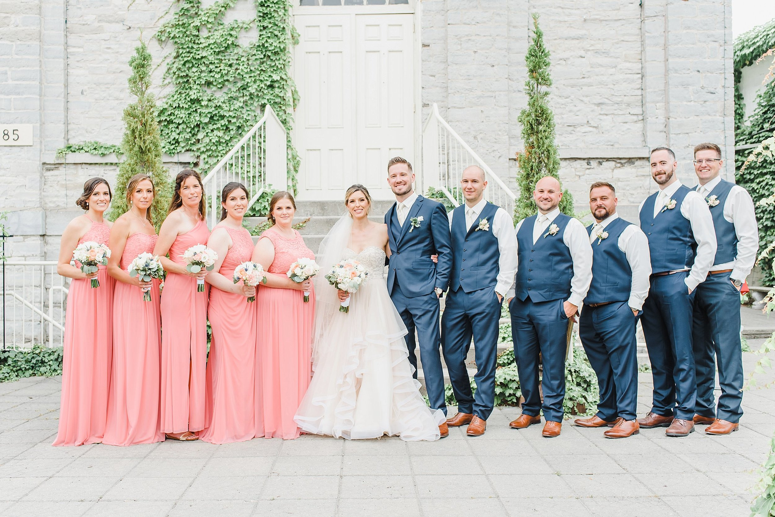 The rain started pouring a few minutes after the ceremony took place, so we took cover and went on over to the reception space, the Renaissance Events Venue, where the rain decided to hold off a little longer for bridal party portraits!