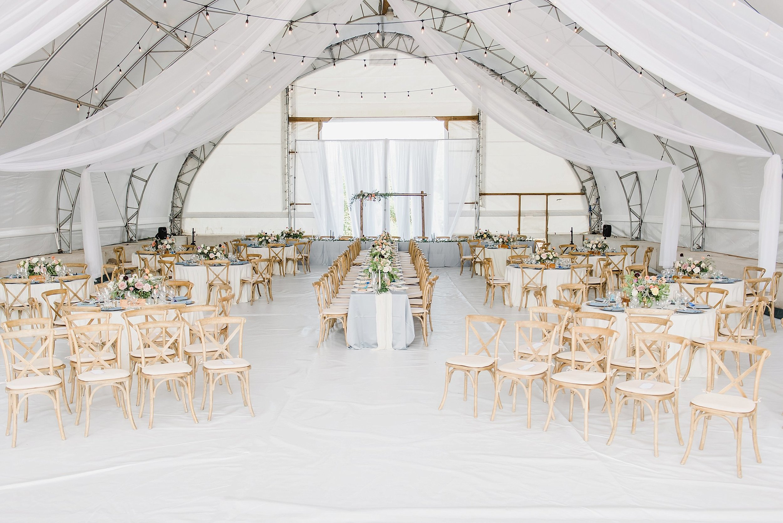 With a sudden onset of rain, the ceremony was pushed right inside the reception space, where the cocktail was also held.  It kept everything even more intimate and special!
